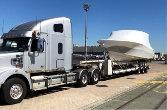 Home, Global Boat Transport, transporting, boats, trailer, hydraulic, oversize, police, permits, insured, engines, equipment, roads, superboats.